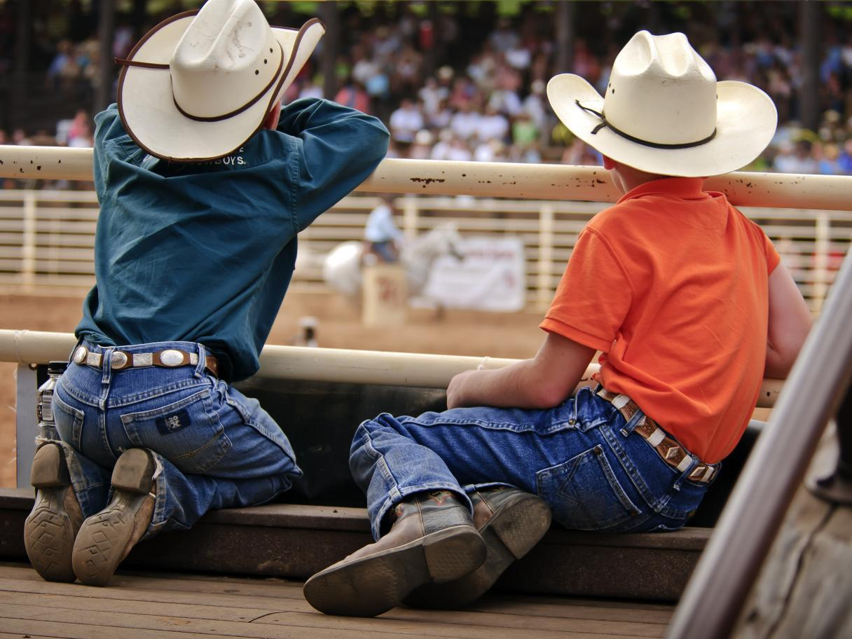 Two boys watch the Rodeo