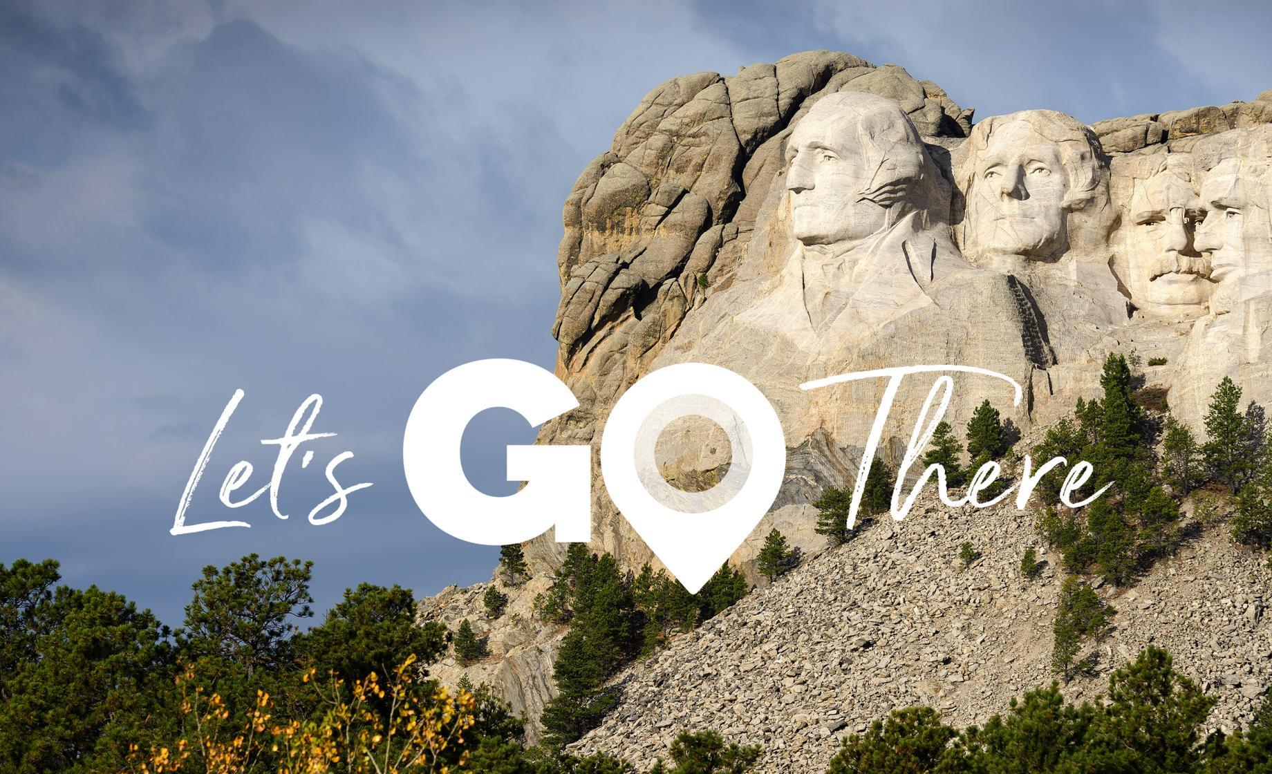 US Travel Association Let's Go There Campaign Lockup Mount Rushmore