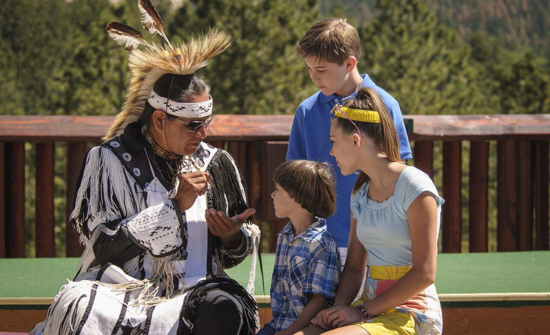 Native American with visitors