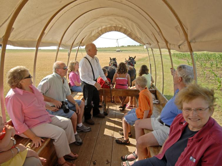 Covered wagon ride on the prairie