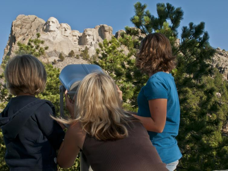 Viewing Mount Rushmore through a tower viewer