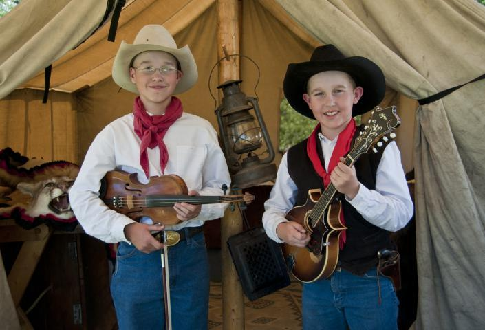 Boys playing instruments at Fort Sisseton