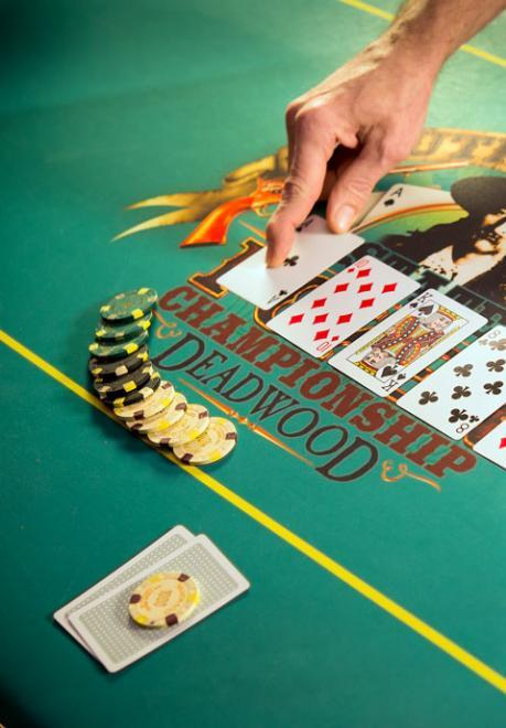 Poker cards and chips on a gaming table in Deadwood